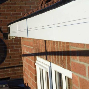 new fascias and soffits completed roof tiles replaced